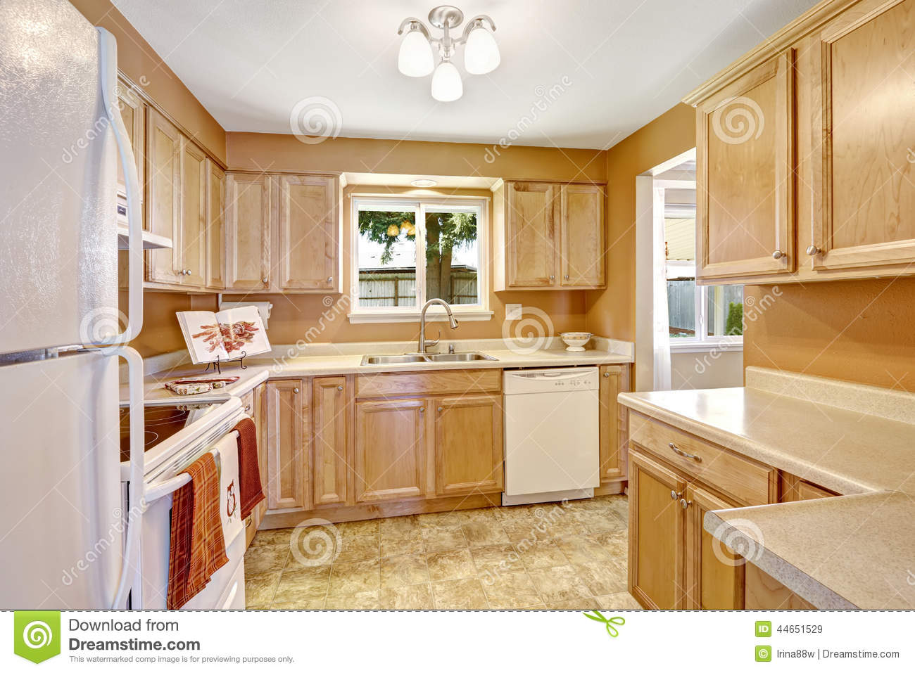 White Kitchen Appliances With Wood Cabinets new kitchen cabinets with white appliances stock photo - image
