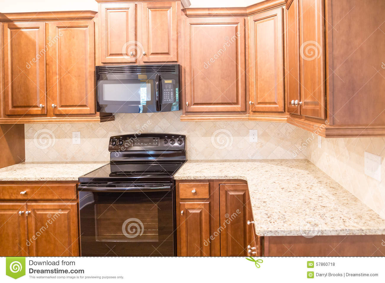 New Kitchen With Granite Countertops And Black Appliances
