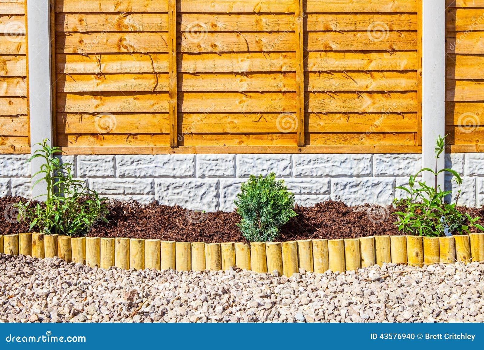 Garden border fence home design and decorating new landscaped wood chip garden border stock photo image garden idea baanklon Images