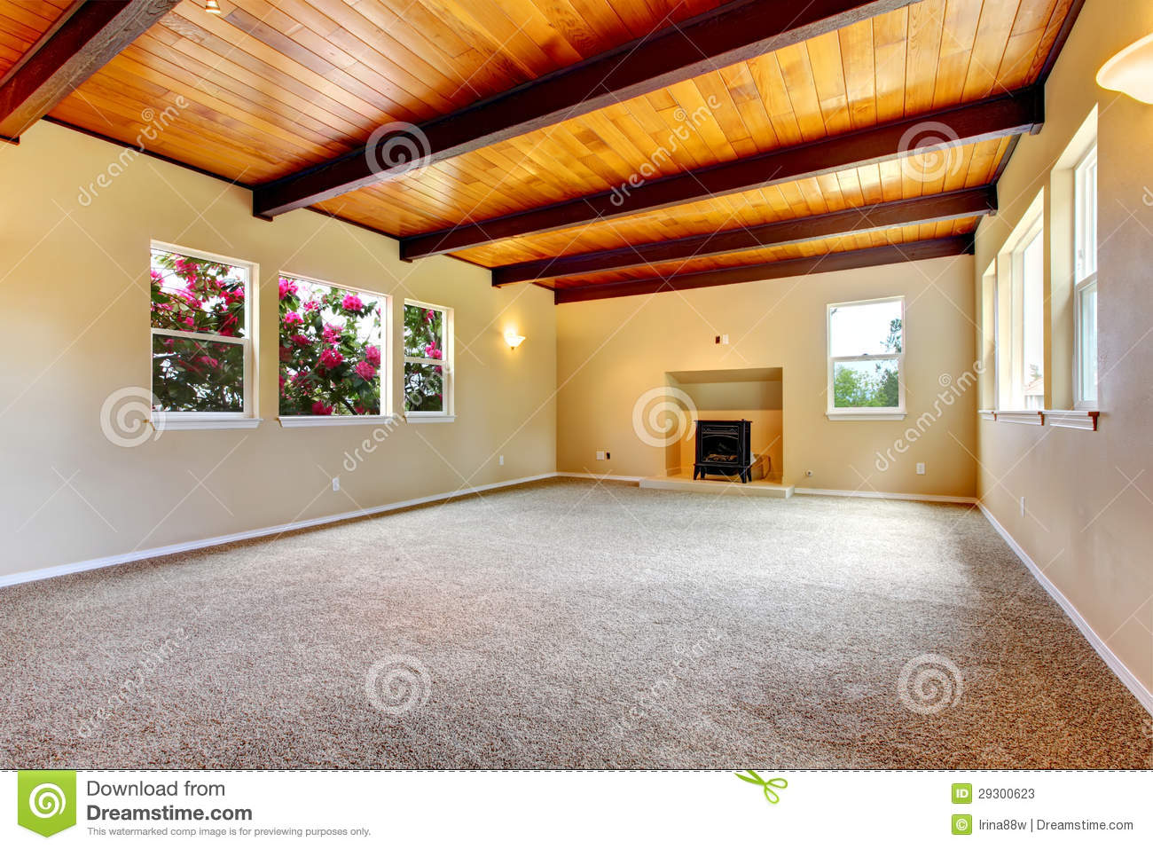 New Large Empty Living Room With Wood Ceiling And Fireplace  Stock