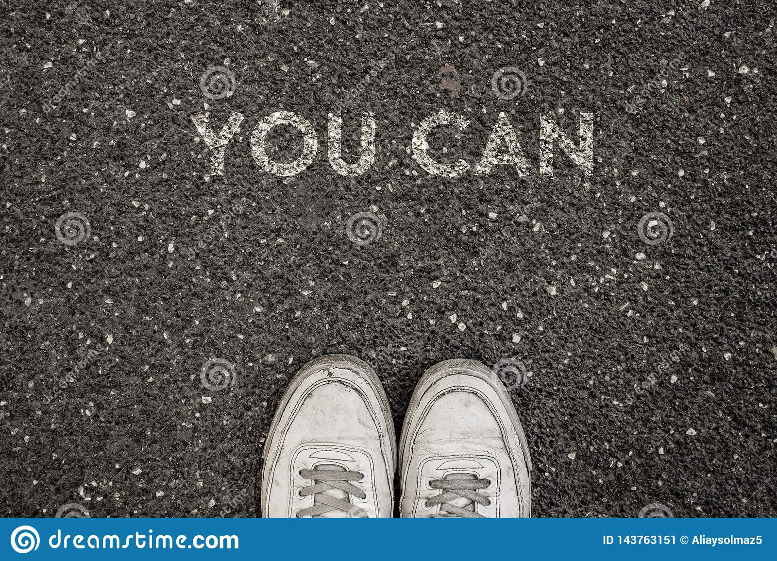 New Life Concept, Motivational Slogan with Word YOU CAN on the ground of asphalt