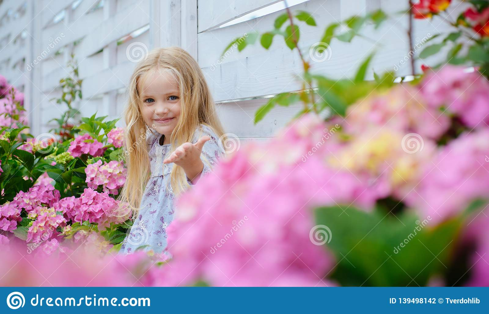 New life concept. Spring holiday. Summer. Mothers or womens day. Childrens day. Small baby girl. Little girl at blooming
