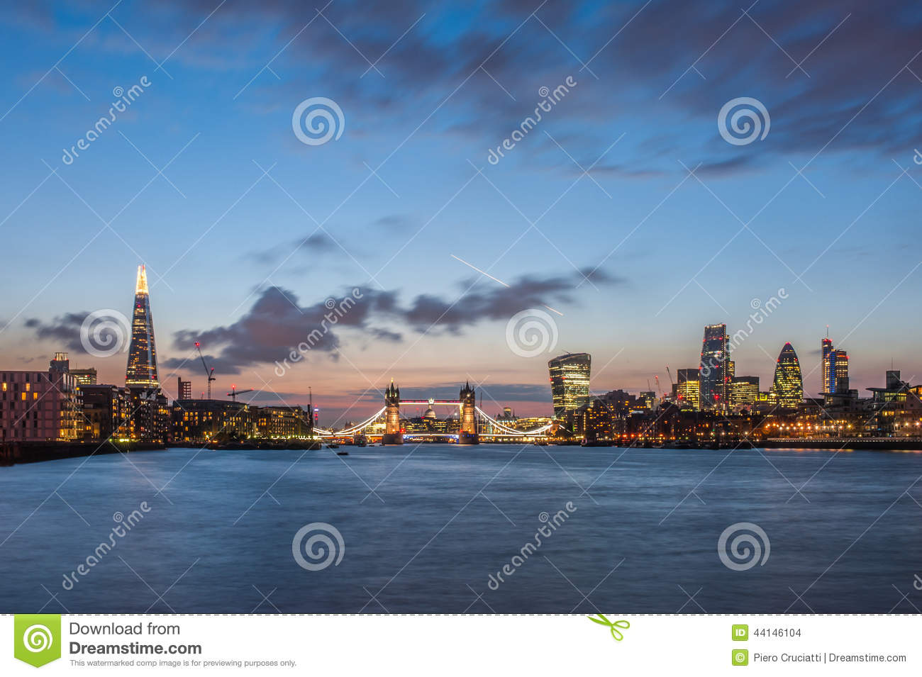 The new London skyline at night with The Shard, Tower Bridge and the skyscrapers of the City