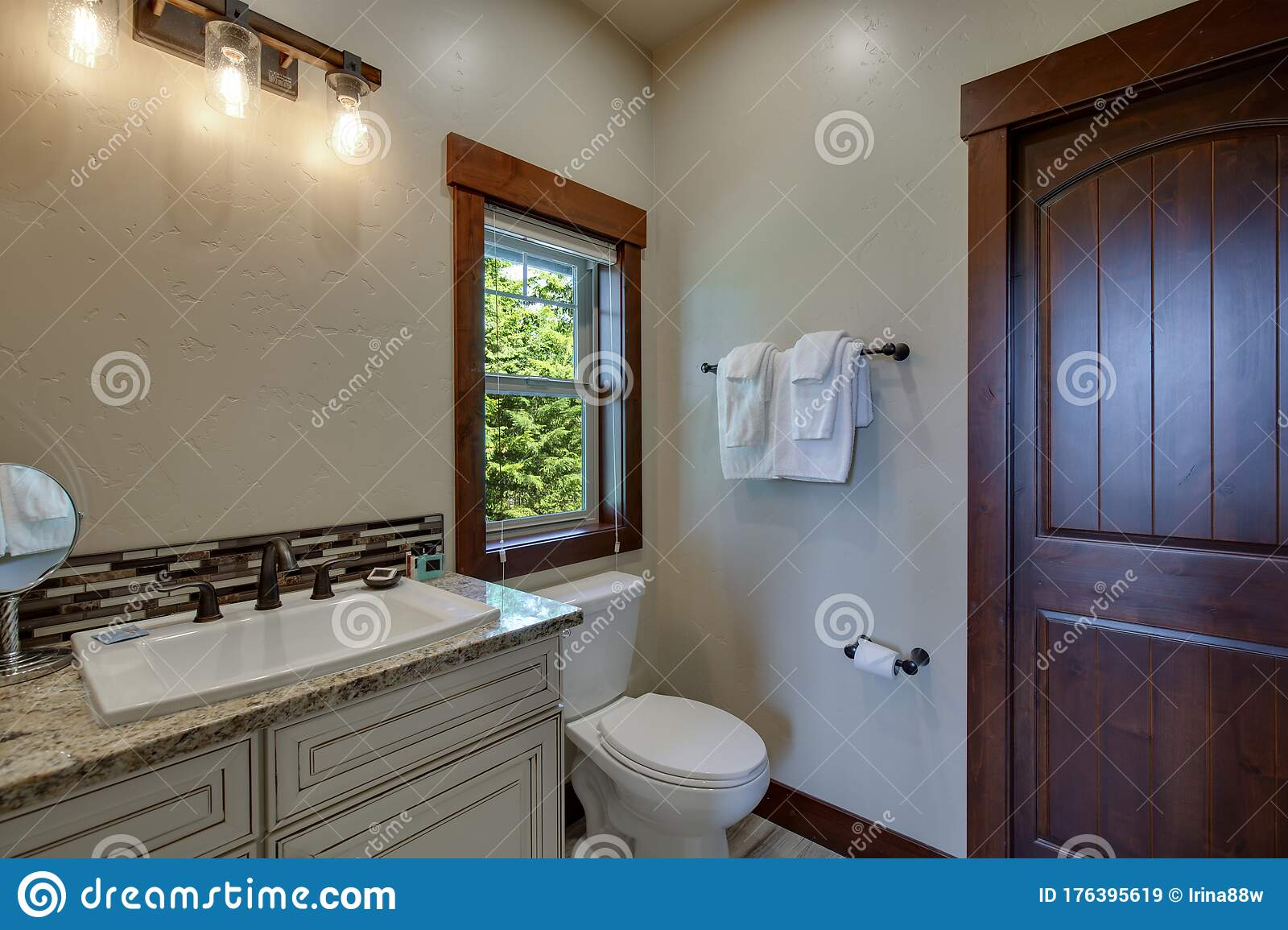New Luxury Bathrooms With Rich Color Wooden Doors Natural Beige Countertops White Cabinets And Sinks Bright Clean Grey Walls Stock Image Image Of Light Cabinets 176395619