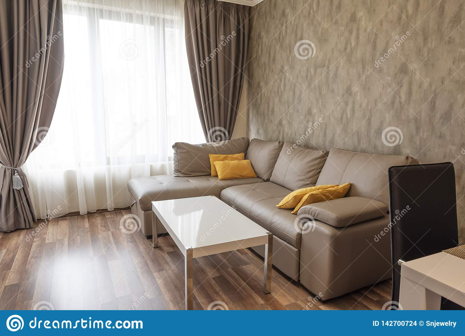 New Modern Living Room New Home Interior Photography Wooden Floor Sofa Near The Windows With Long Curtains Stock Photo Image Of Curtains Beautiful 142700724