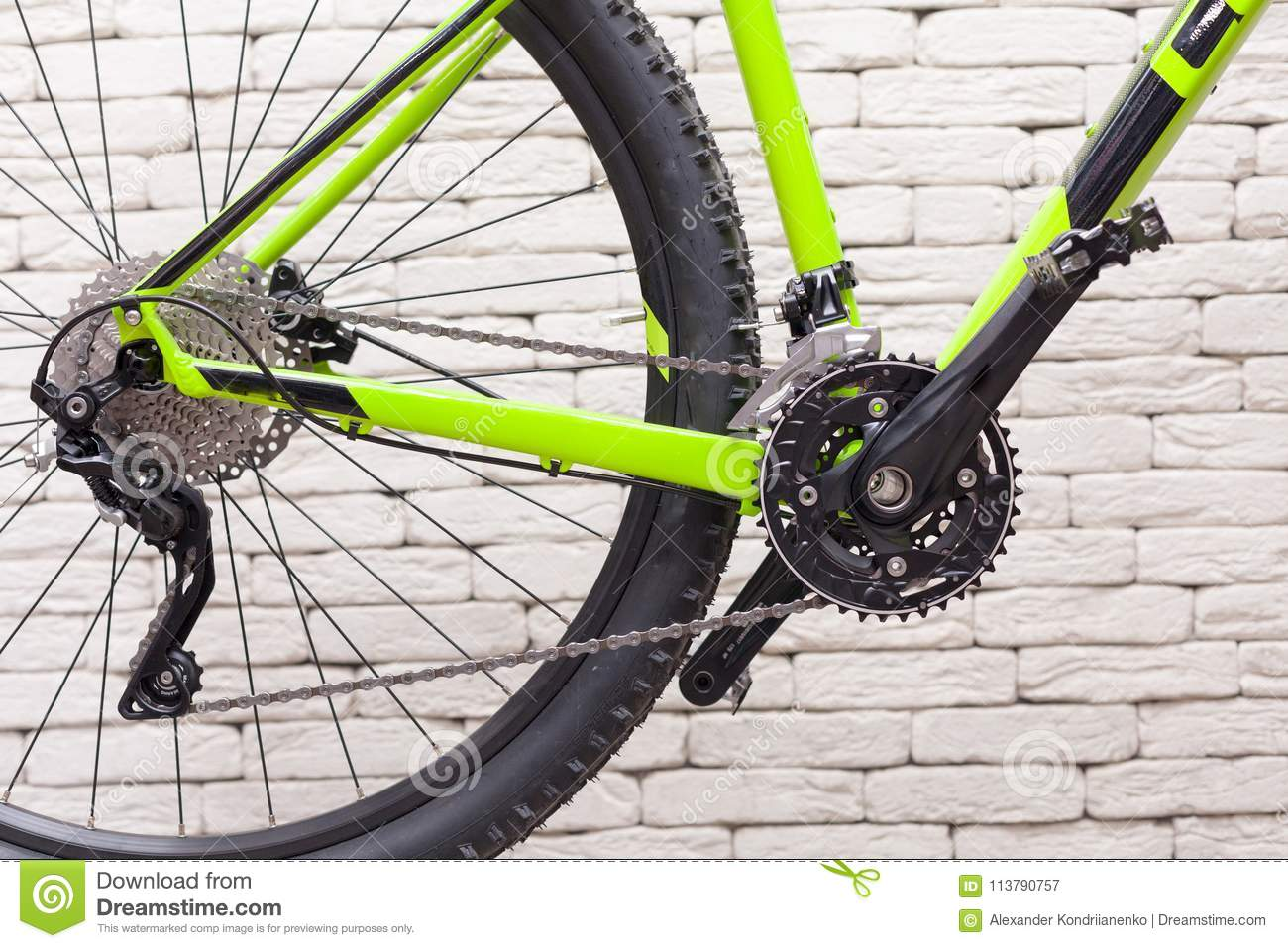 Bicycle chain against a white brick wall. Bicycle sprockets