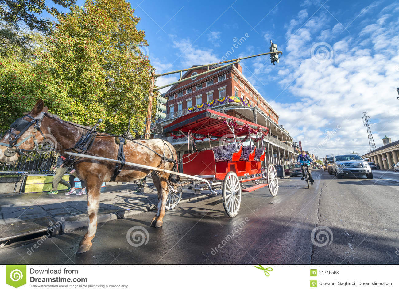NEW ORLEANS, USA - FEBRUARY 2016: Red horse carriage along Jacks