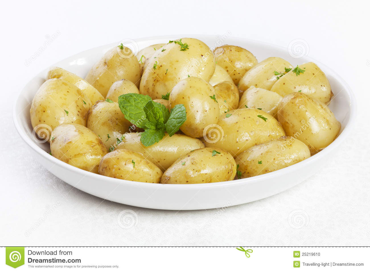 New Potatoes With Butter Parsley And Mint Stock Photo ...
