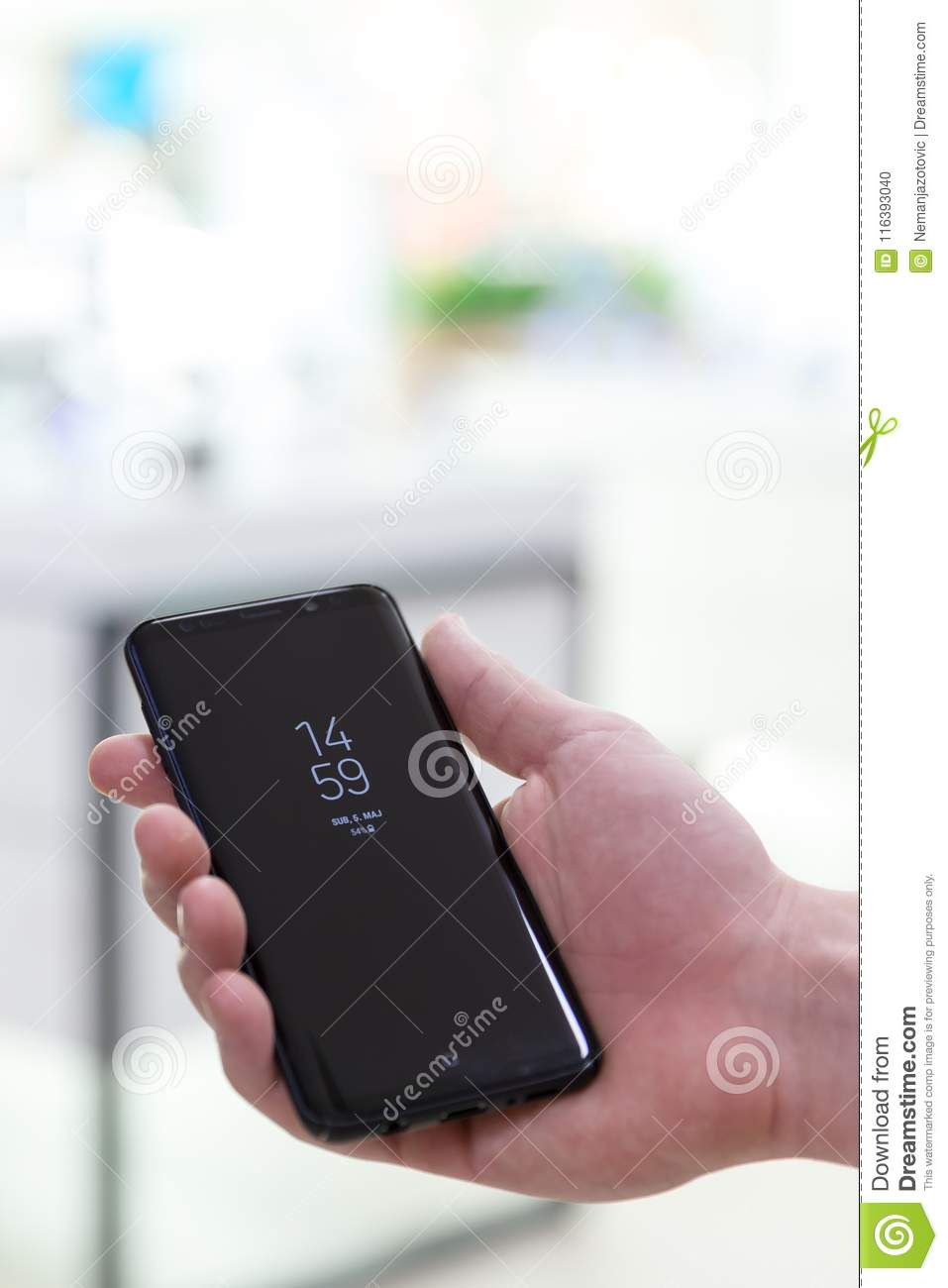 New Samsung Galaxy S9 Plus Smartphone In Hand On Isolated