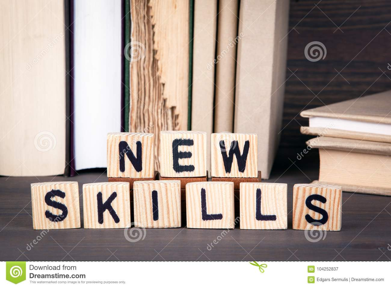 New skills, wooden letters on wooden table. Education, success and communication background