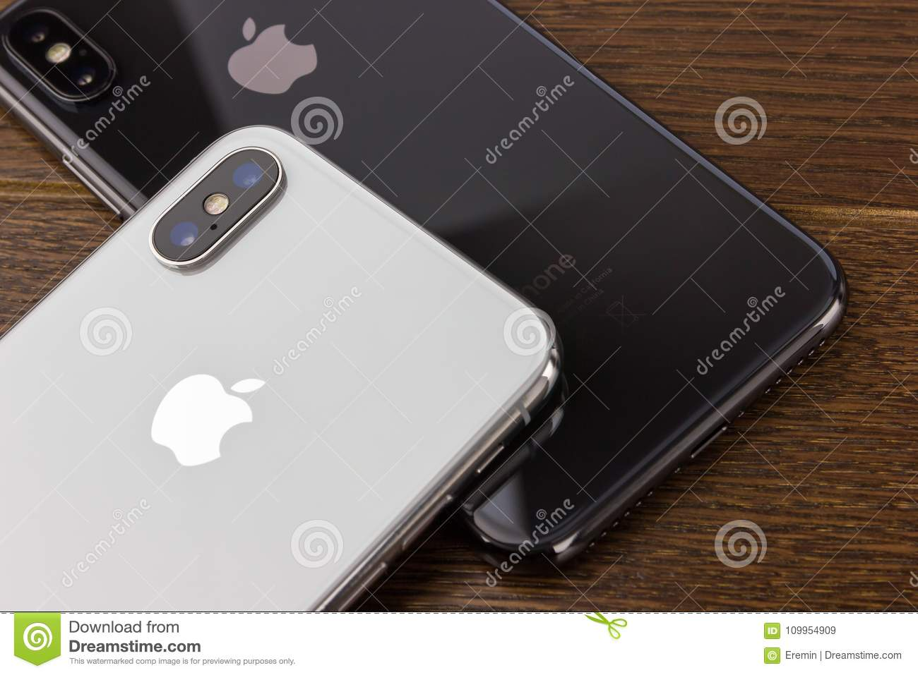February 2018 Two Iphone X Lies On A Wooden Table Editorial Stock