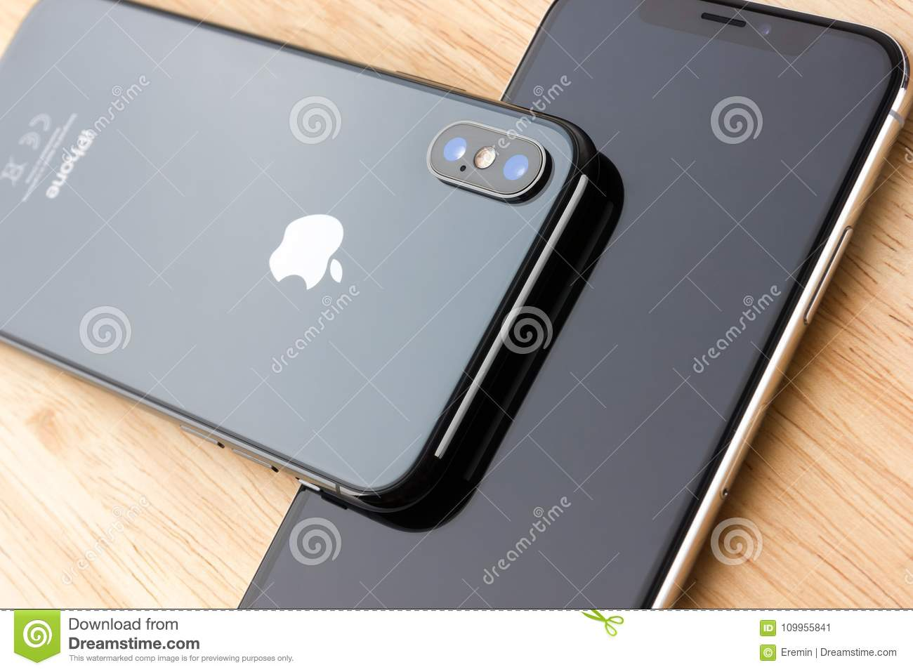 February 2018 Two Iphone X Lies On A Wooden Table Editorial Photo