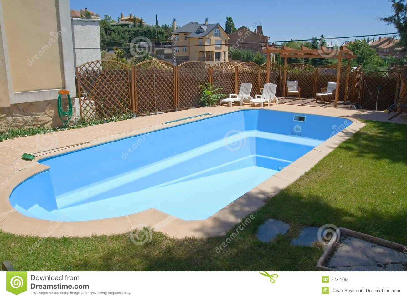 New swimming pool in a garden royalty free stock photo for New swimming pool