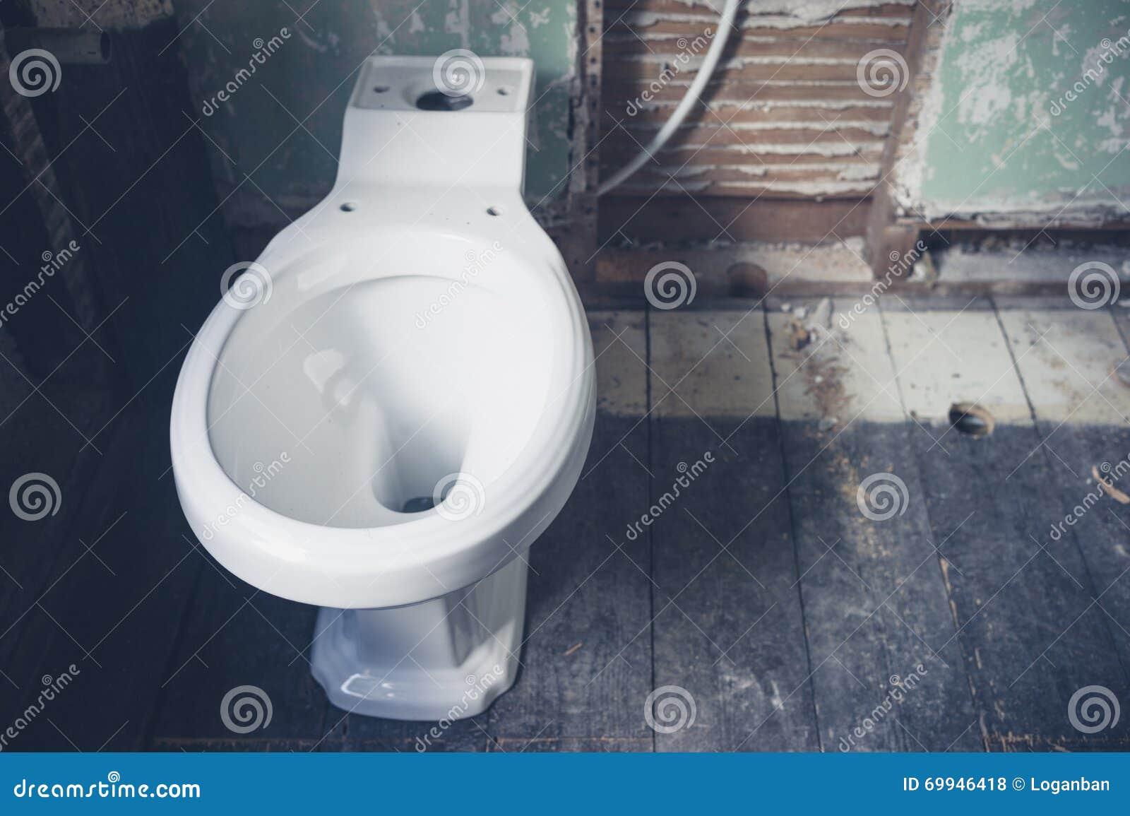 New Toilet In Derelict Bathroom Stock Photo - Image of renovation ...