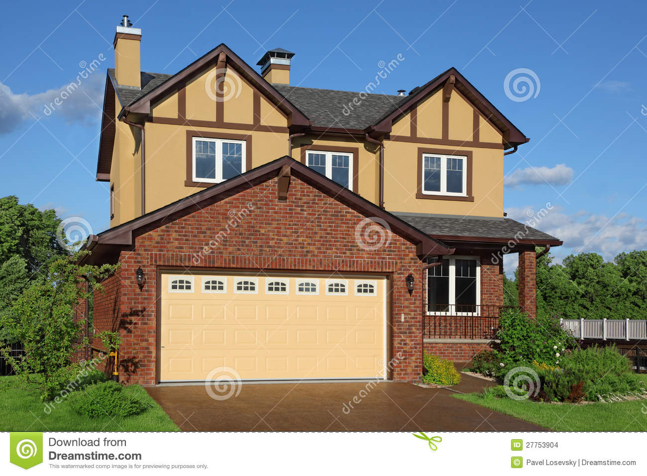 New Two storied Brown Cottage With Built in Garage Stock