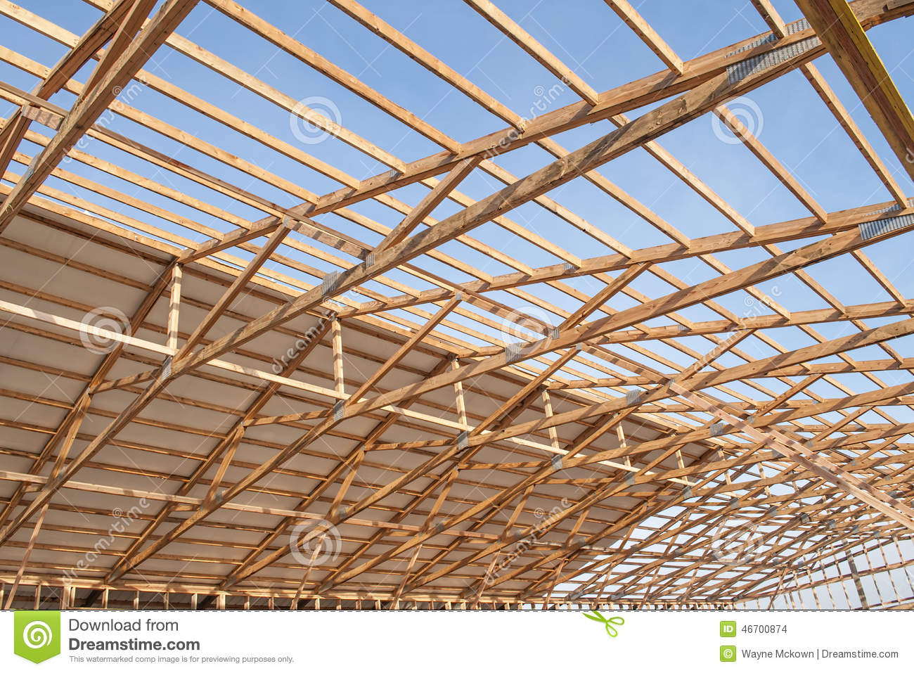 New wood frame barn construction stock photo image 46700874 for Wood barn construction