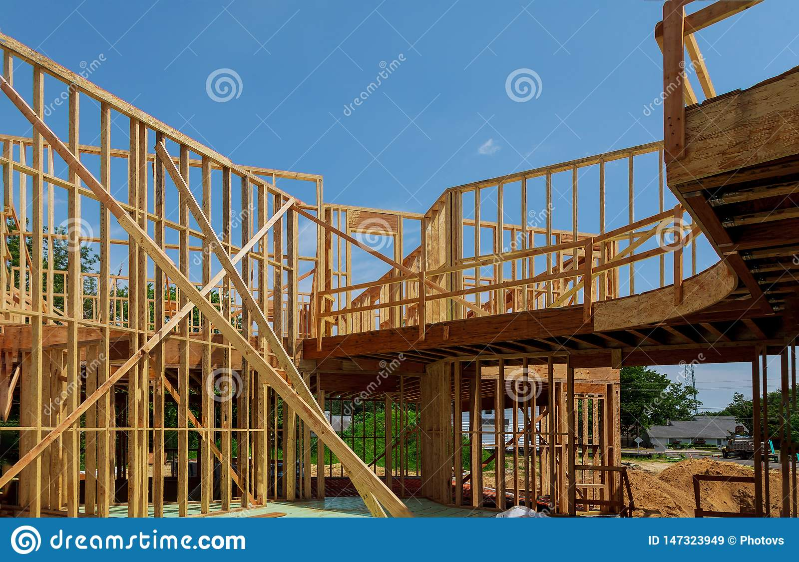 New wooden ecological house from natural materials under construction frame against clear sky from inside