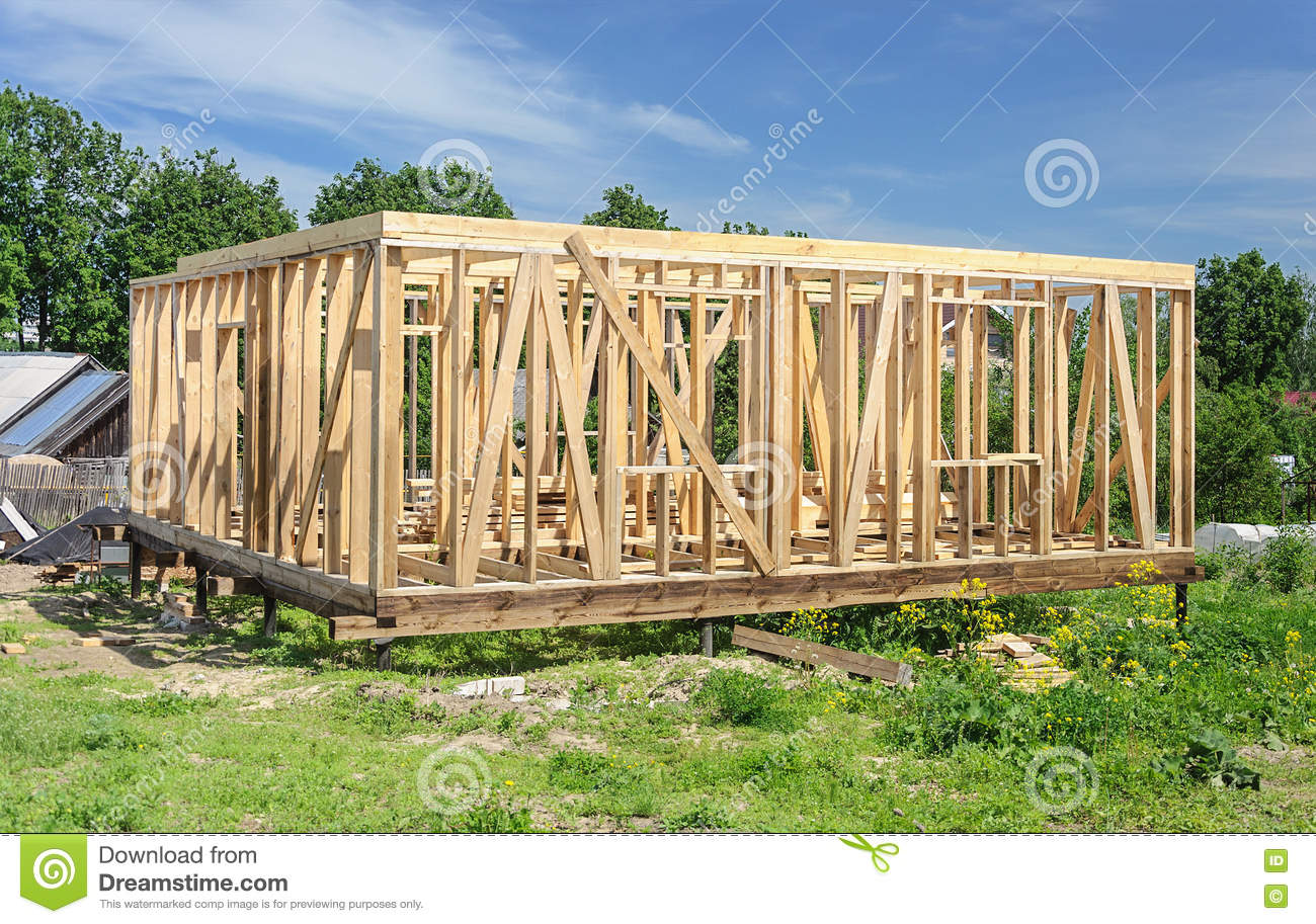New wooden house post and beam construction stock photo for Post and beam construction
