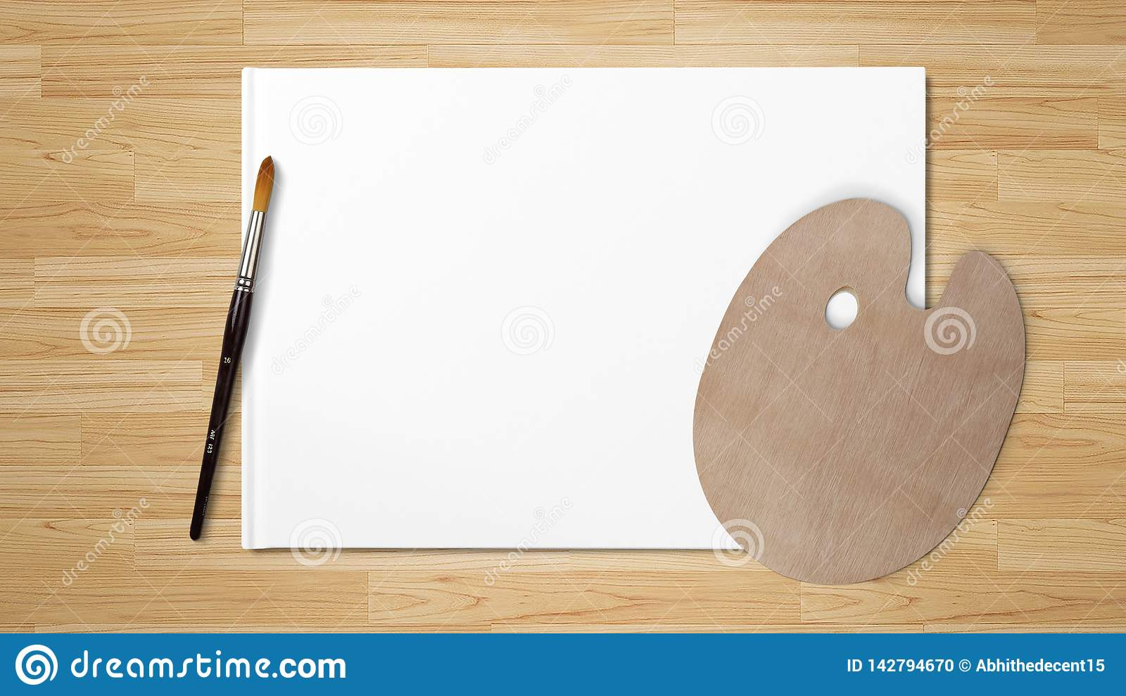 New wooden palette with art brush, isolated on white background and wooden background