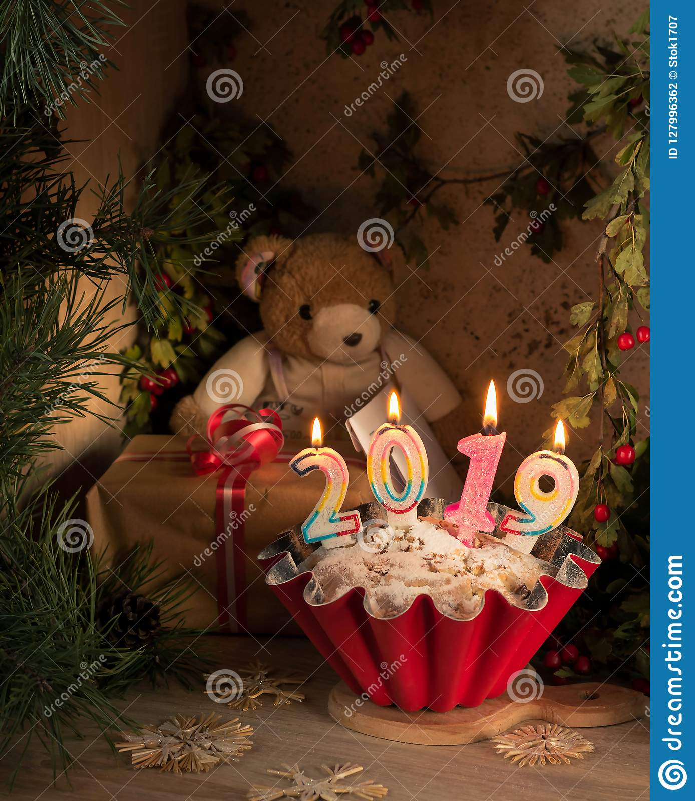 New Year card 2019. Christmas card. Bear with letters sits in front of an apple pie.