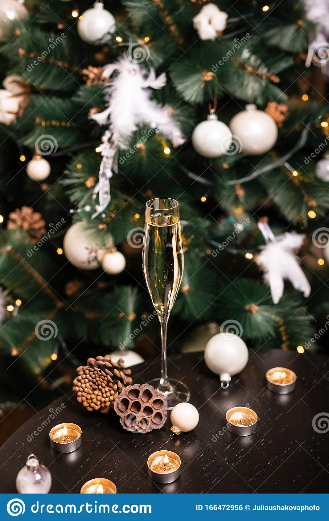 New Year Champagne Against The Background Of Christmas Tree And Bokeh Lights Stock Photo Image Of Crystal Chardonnay 166472956