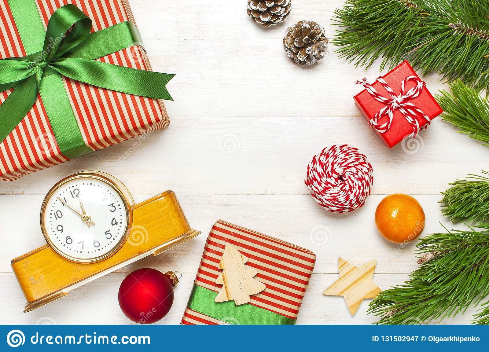 New Year Or Christmas Background Retro Alarm Clock Pine Branches Cones Gifts Presents Toys Red Ball On White Wooden Stock Image Image Of Deadline Celebration 131502947