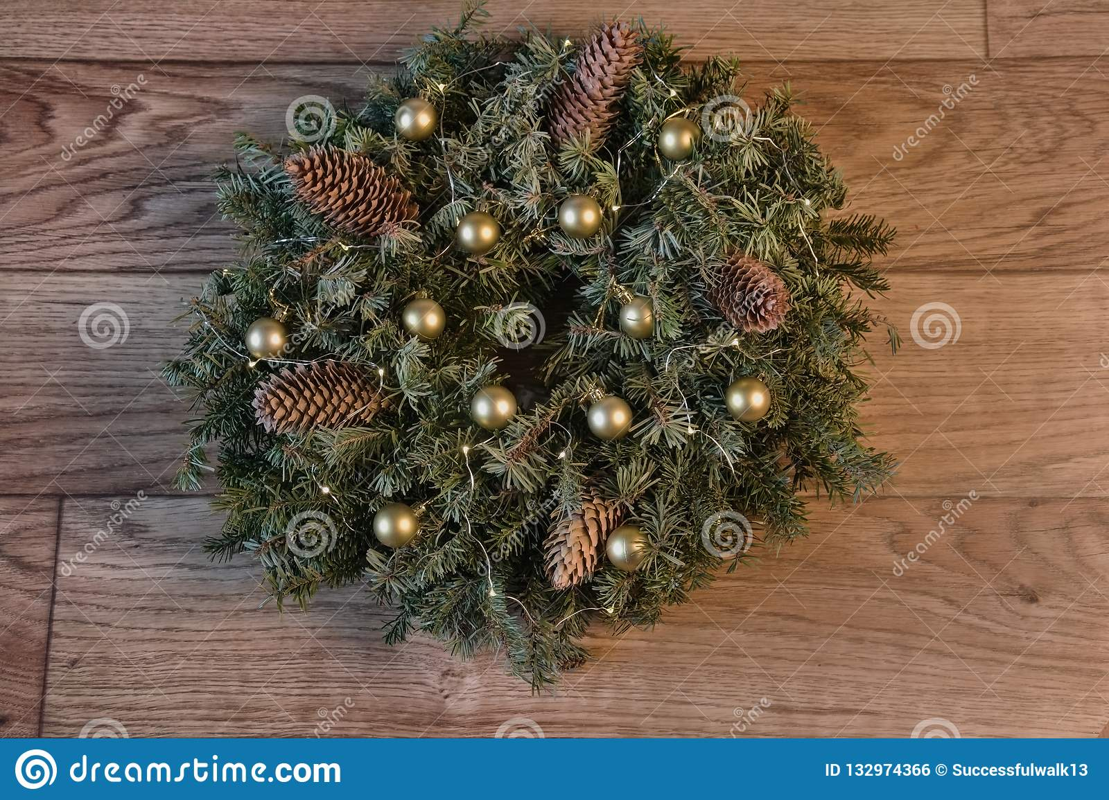 A Wreath Of Fir Branches With Cones Lights Garlands And