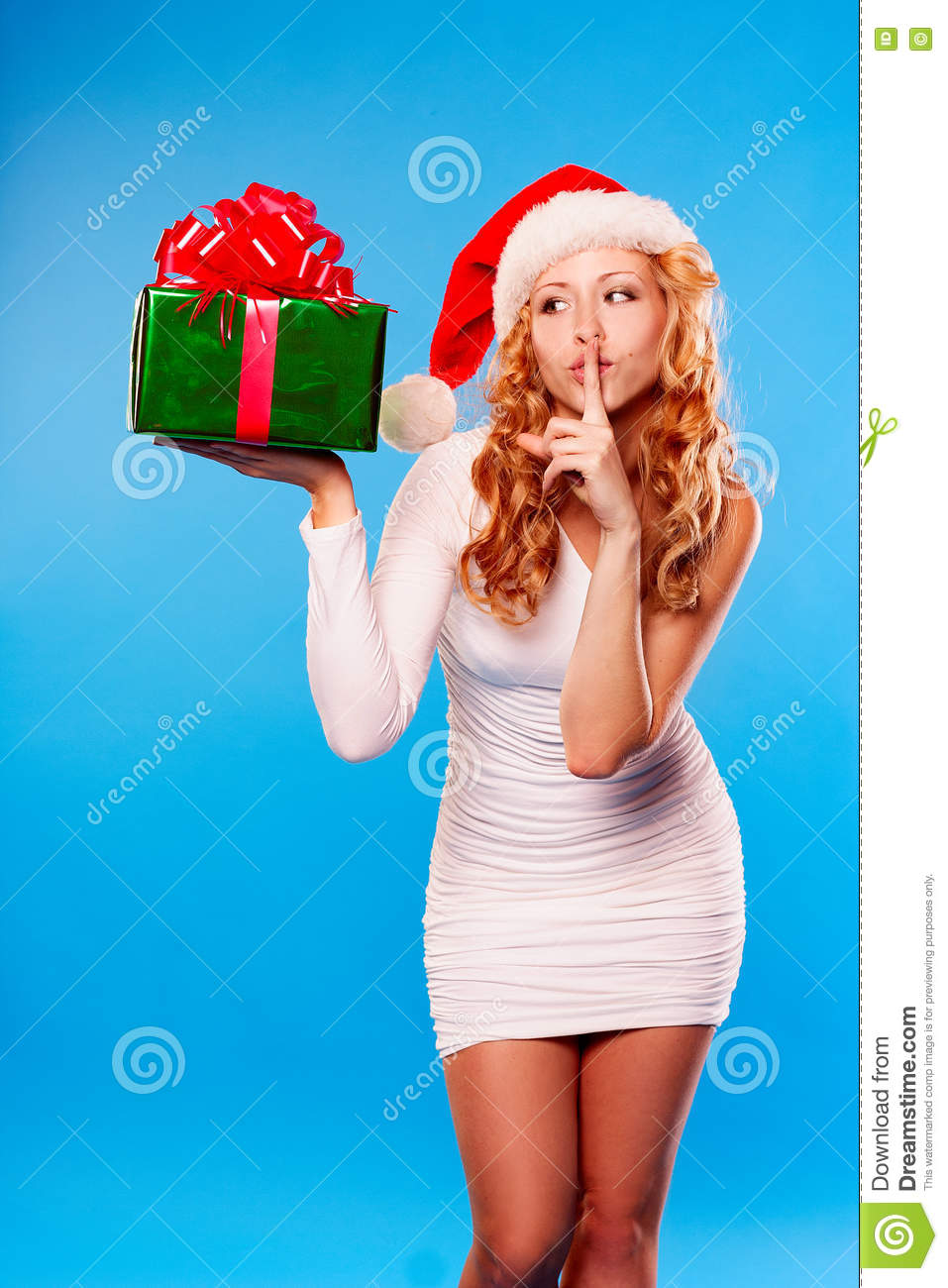 new year christmas x mas woman in santa helper hat with present in hands saying shh silence sign