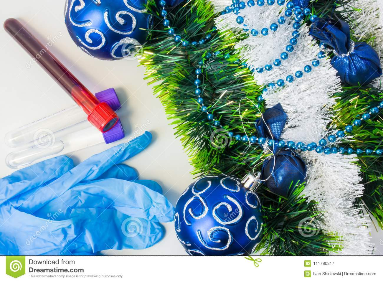 New Year and Christmas in medical, clinical or scientific laboratory. Protective gloves and laboratory test tubes with blood sampl