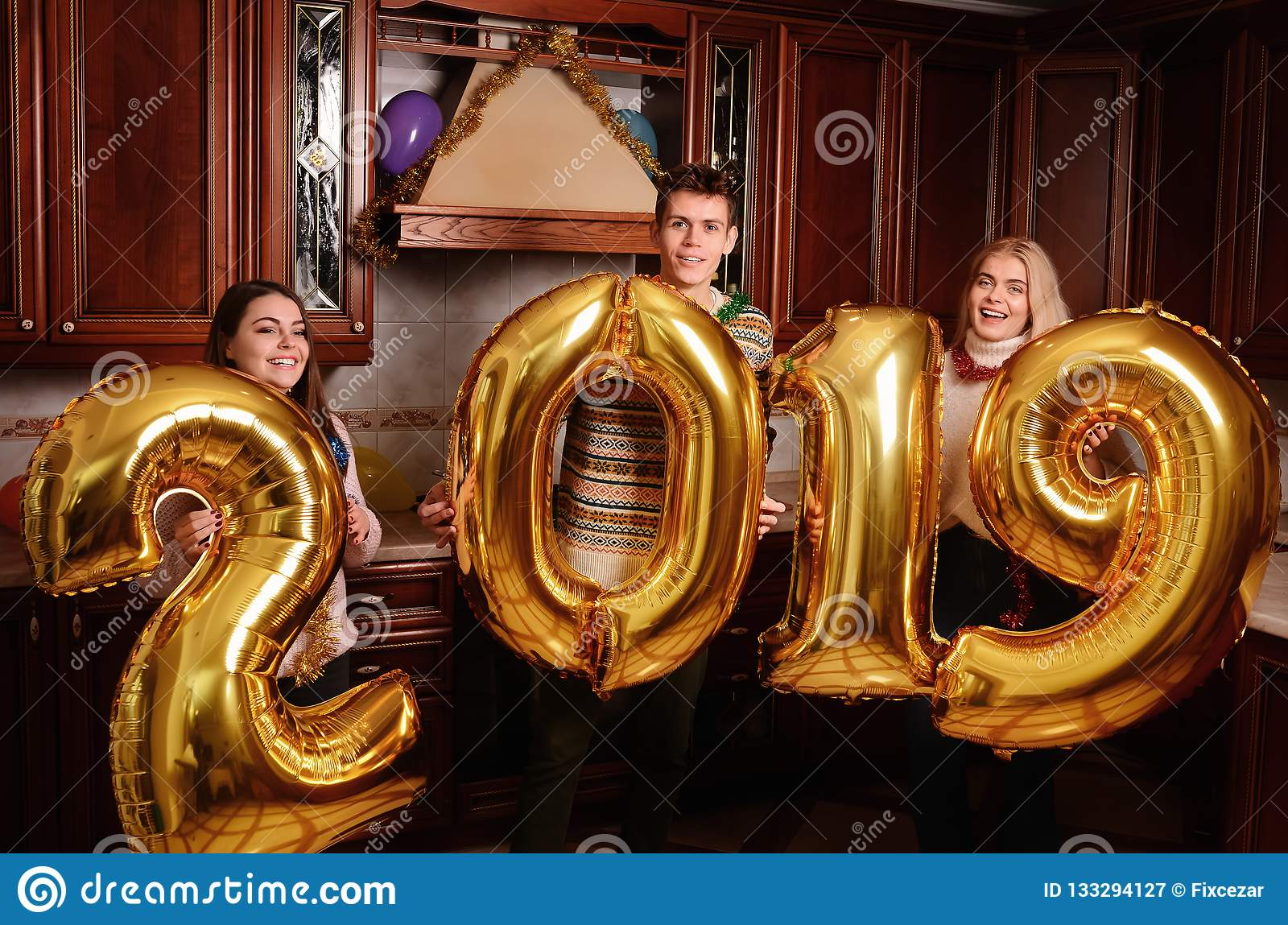 New 2019 Year is coming. Group of cheerful young people carrying