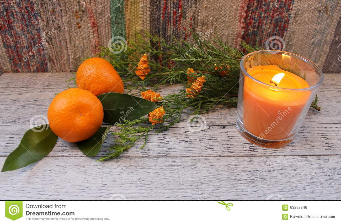 New Year composition with tangerines, arborvitae branch, candles and Christmas trees