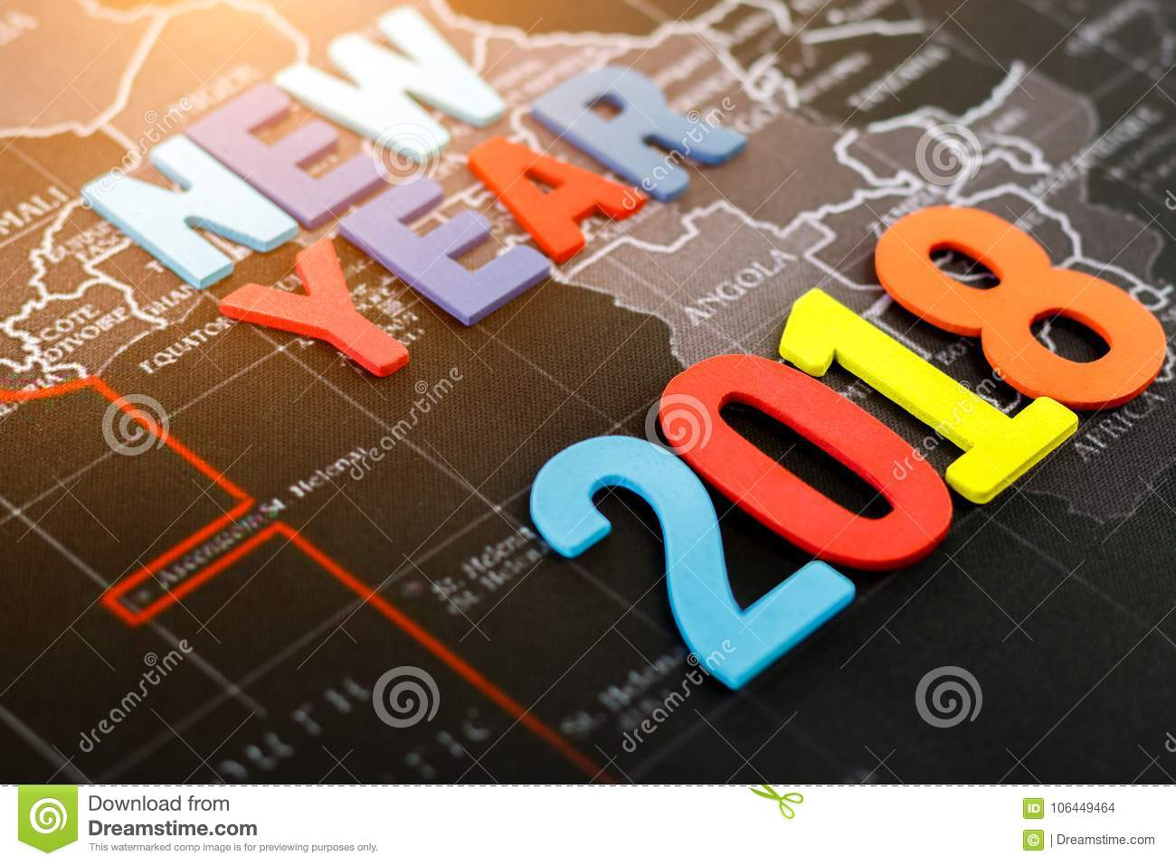 Color full word new year with number 2018 on black world map.