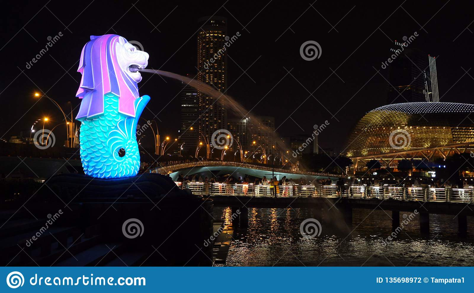 New Year Countdown 2019 at Merlion with colorful lights in Downtown Singapore City at night with skyscraper buildings background
