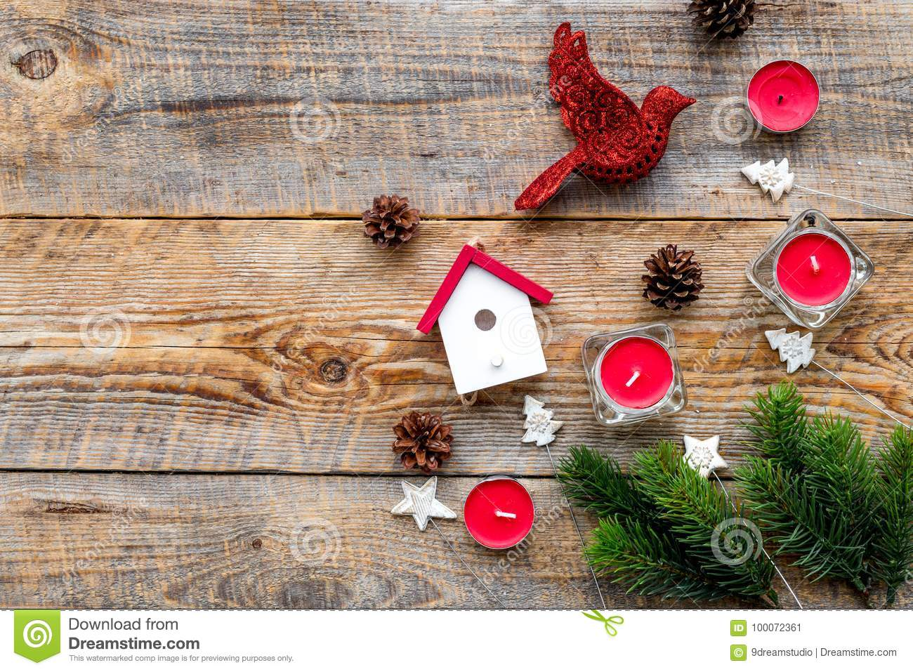 download new year decorations with bird house toys and christmas tree branche on wooden background - Bird House Christmas Decoration