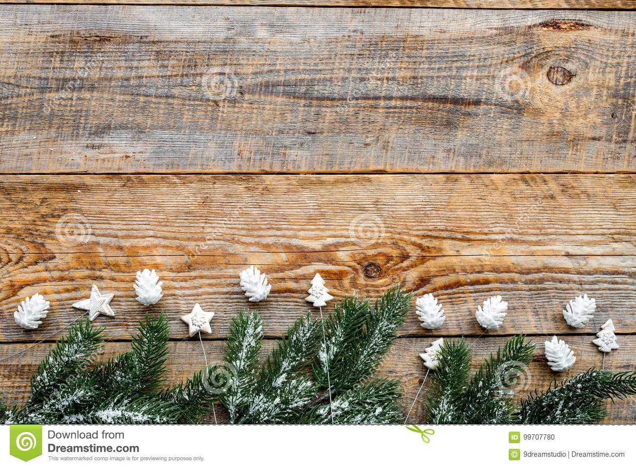 new year decorations with toys and christmas tree branche on wooden background top veiw mock up - New Toys For Christmas