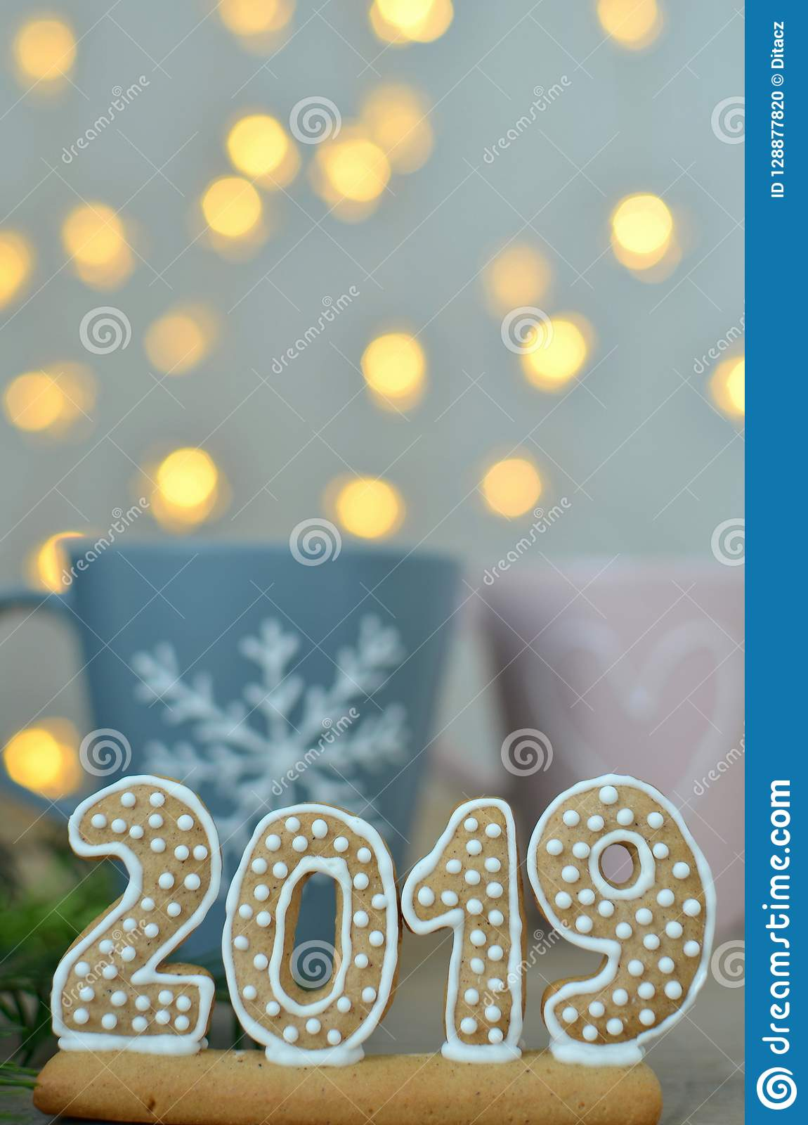 2019 Christmas Lights New Year 2019. Gingerbread Figures On A Wooden Board. Christmas