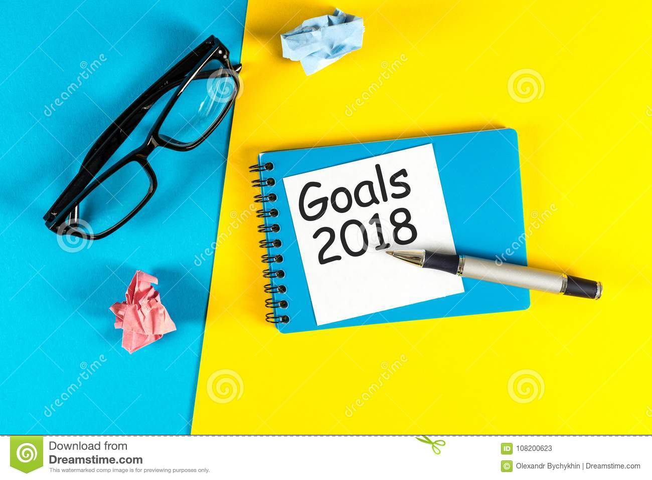 New Year Goal Text On Notepad With Office Accessories Business