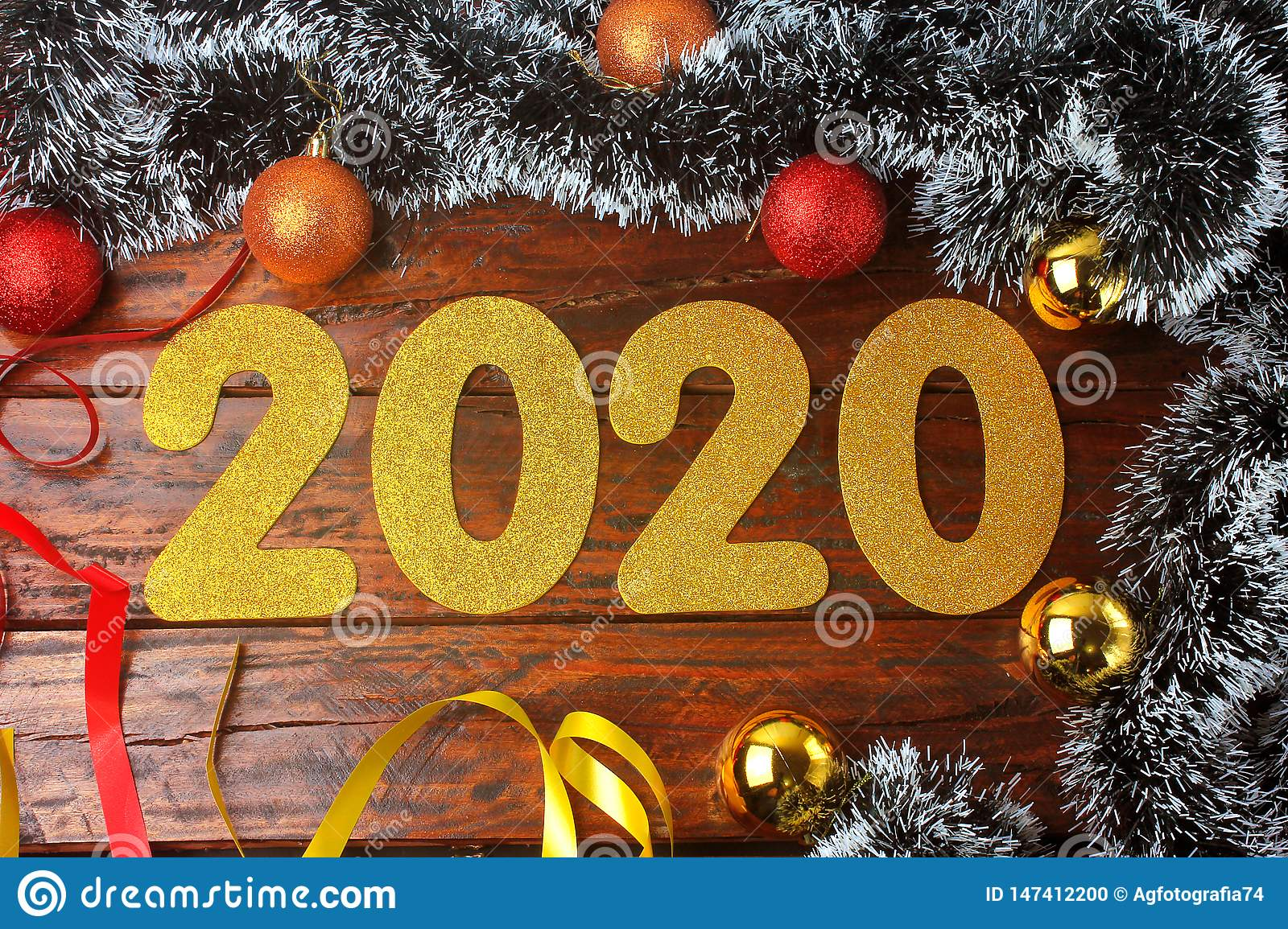 2020 new year, golden numbers on ornate rustic wooden table in festive celebration