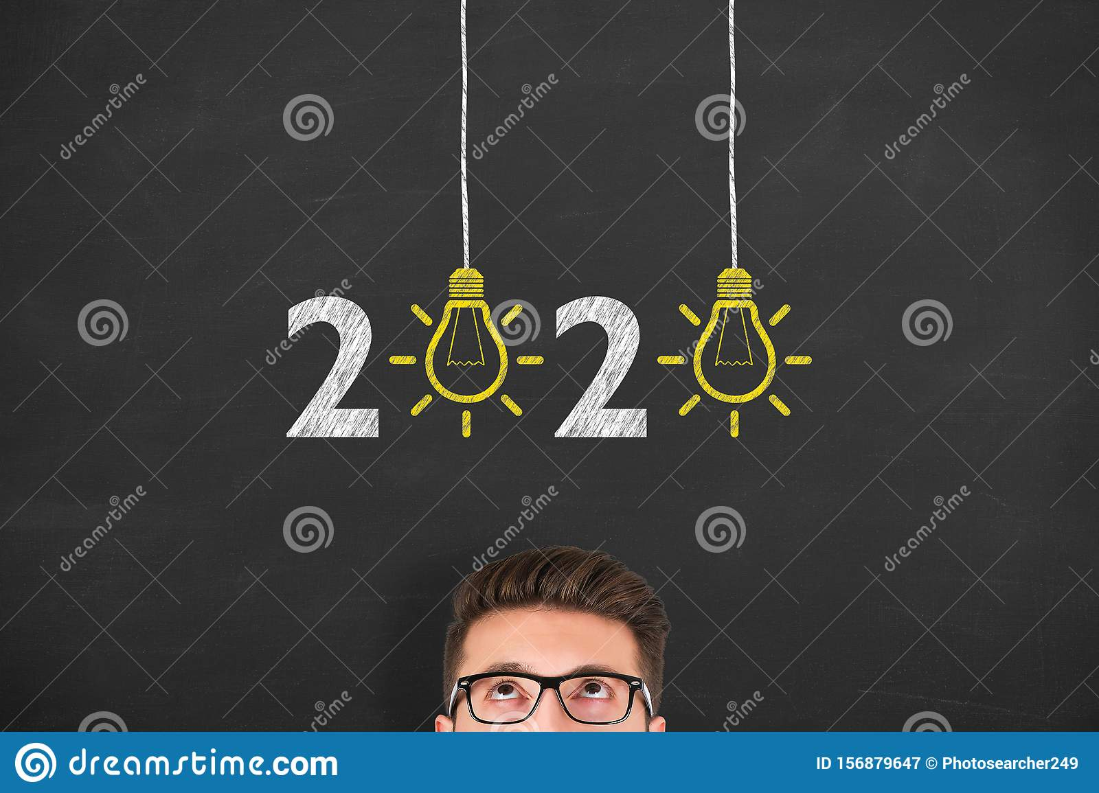 New Year 2020 Idea Concepts over Human Head on Blackboard Background