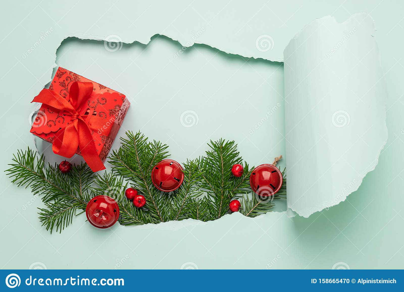 New Year Layout Hole Paper Background Mint Color Christmas Tree Toys Branches Gift With Red Bow Blue Bright Background Stock Photo Image Of Gold Background 158665470