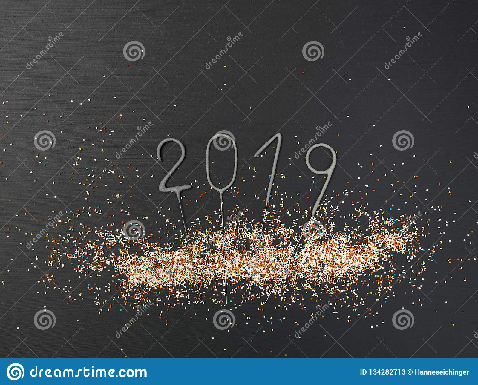 New Year`s background with lettering 2019 and many colorful balls on black background