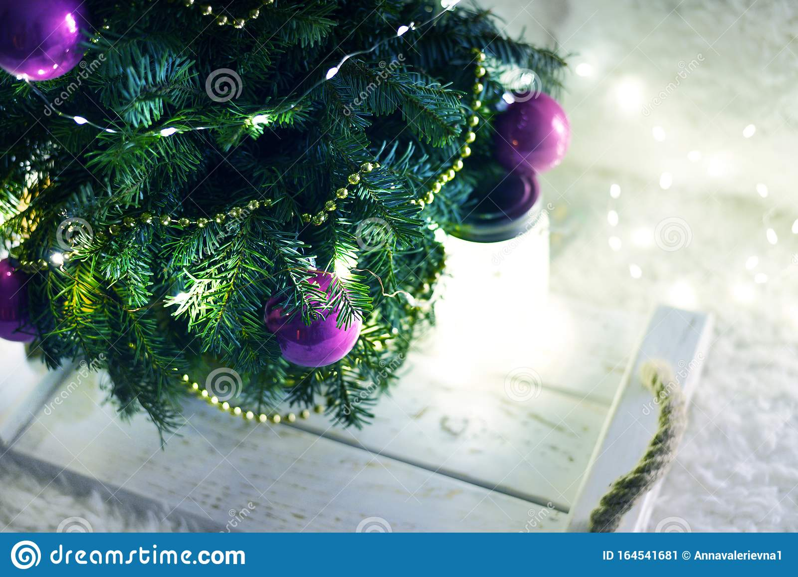New Year`s Christmas scenery. Christmas tree branches with toys