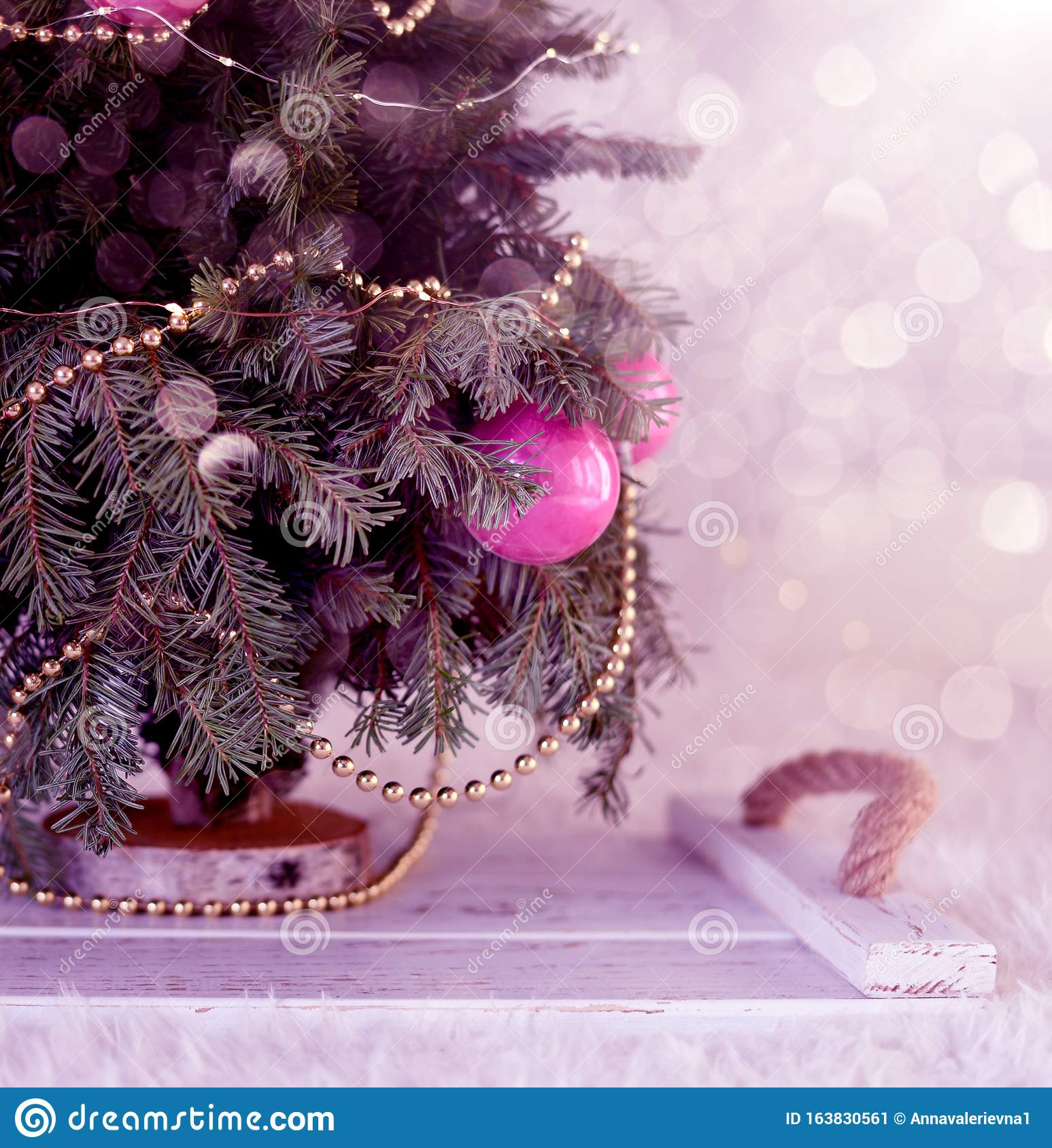 New Year`s Christmas scenery. Christmas tree branches with toys and sparkling lights.