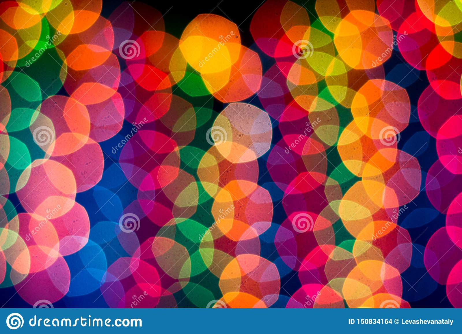 New Year`s rainbow bokeh. Holiday rainbow christmas lights bokeh background.