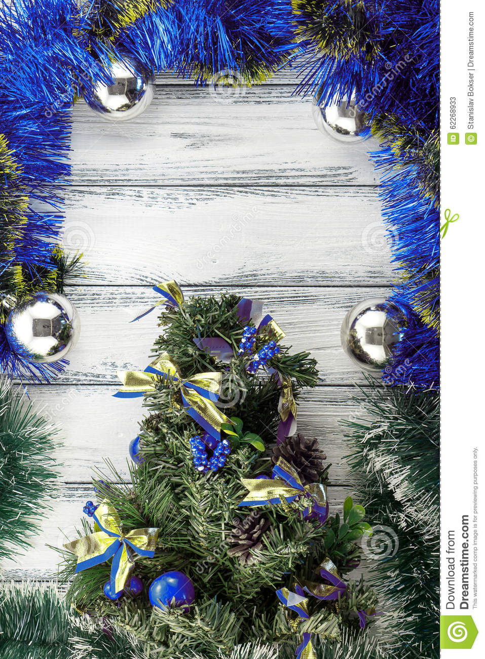 new year theme christmas tree with blue and green decoration and silver balls on white - Green Christmas Tree With Blue Decorations