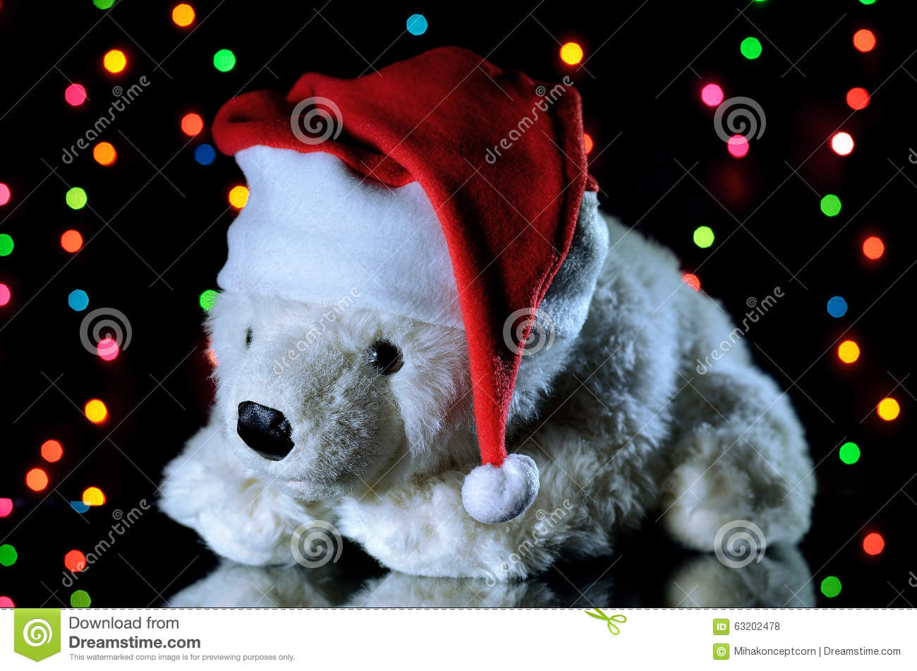 new year 2016 white teddy bear in a christmas hat christmas decoration with garland background for christmas advertising