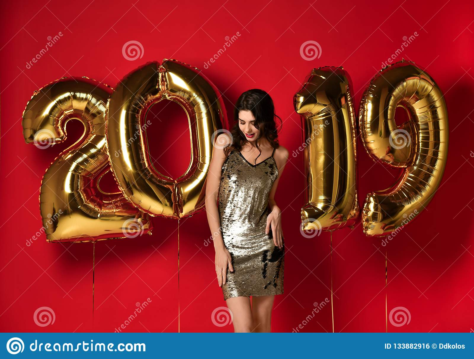 New Year. Woman With Balloons Celebrating At Party.