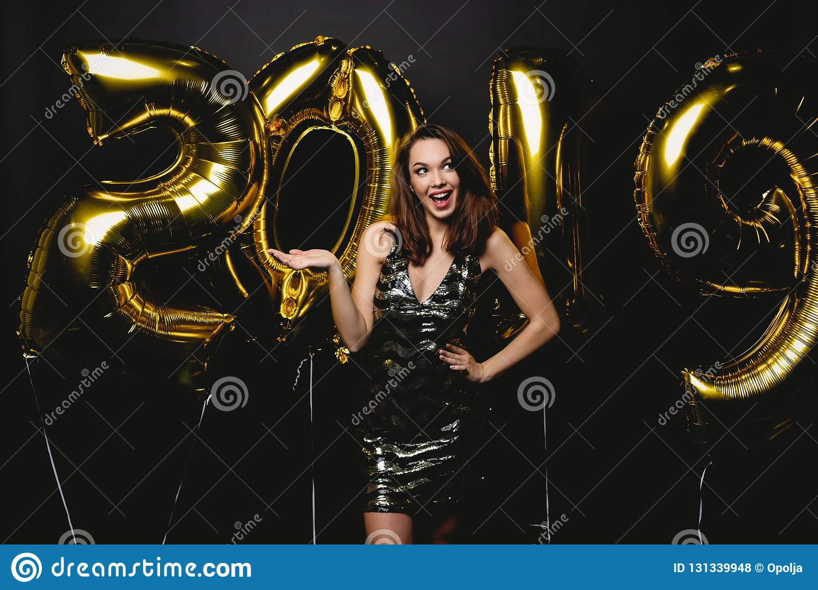 New Year. Woman With Balloons Celebrating At Party. Portrait Of Beautiful Smiling Girl In Shiny Dress Throwing Confetti
