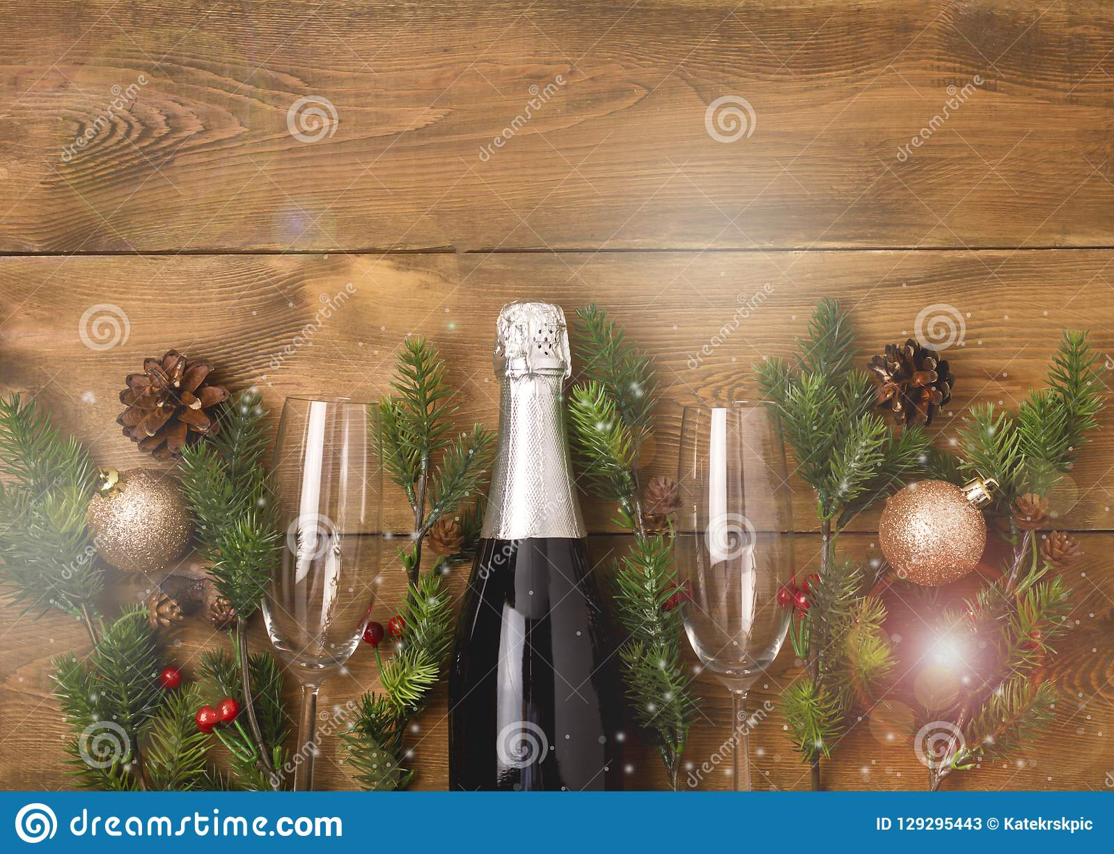 New Years Christmas Celebration Background with Pair of Wineglasses and Bottle of Champagne Christmas New Year Card Fir Decoration