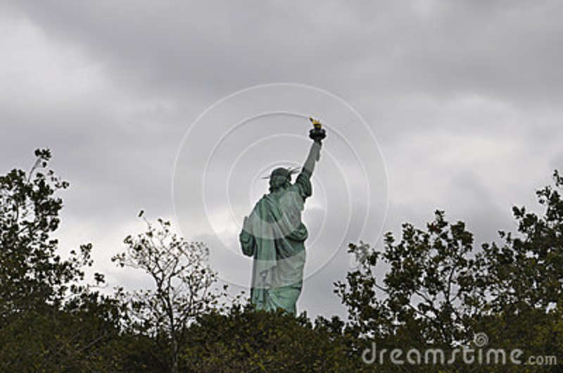New York City,August 2nd:Statue of Liberty on a dramatic sky in New York City